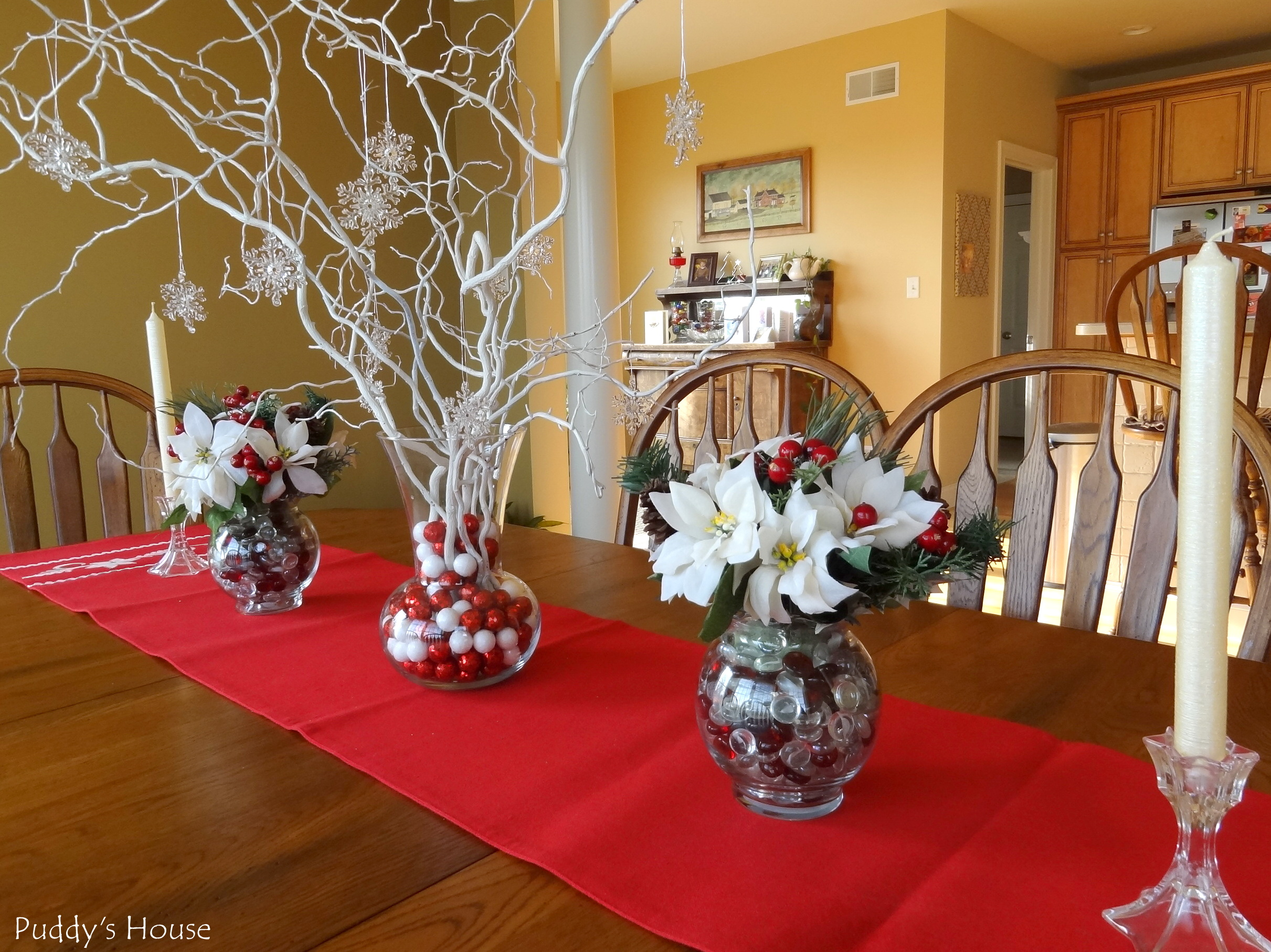 Christmas Diy Centerpieces Sprayed Branches With Snowflakes Poinsettias And Candlesticks