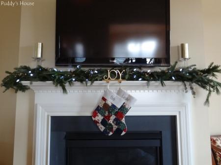 Christmas - Fresh Greens lights and stockings on mantle