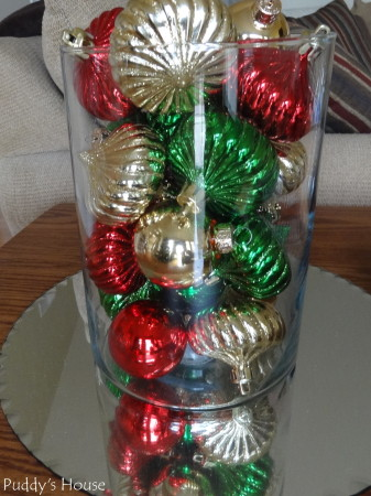 Christmas-Ornaments in vase reflecting in mirror