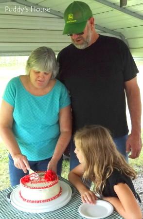Anniversary - mom and dad cutting cake