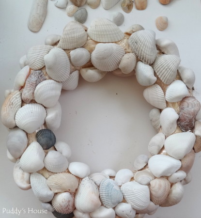 DIY Seashell Wreath - first full layer of shells