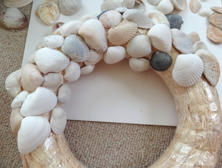 DIY Seashell Wreath - first half layer of shells on wreath