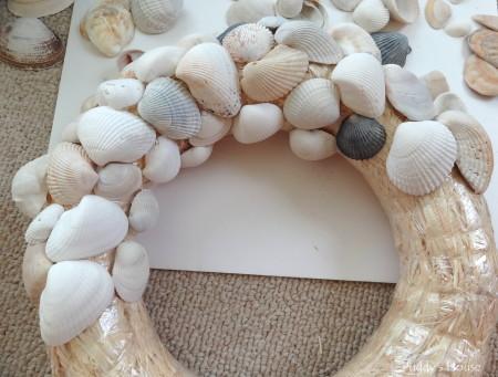 DIY Seashell Wreath - first half layer of shells on wreath