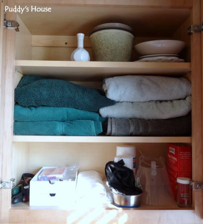 Getting organized - laundry room right cupboard after