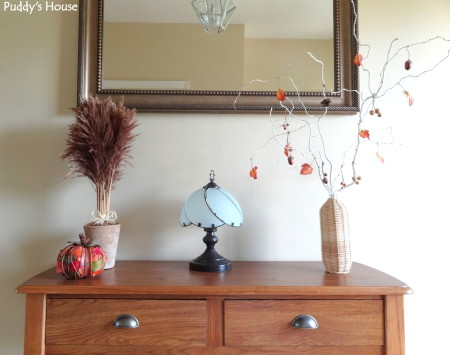 Fall Decorating - Foyer table with painted branches potted wheat and leafy pumpkin