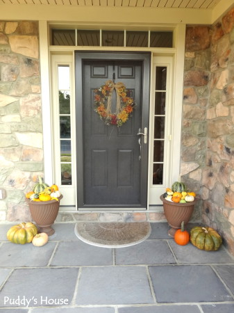 Fall Decorating - front porch with wreath and pumpkins and gourds in flower pots