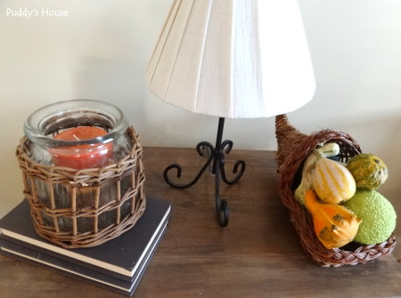 Fall Decorating - guords in cornicopia and fall candle