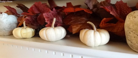 Fall Decorating - white pumpkins and concrete apples with leaves on mantle