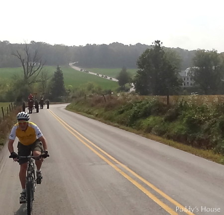 Tractor Ride - bicyclist with tractors coming down hill