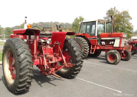 Tractor Ride - two red tractors in lot