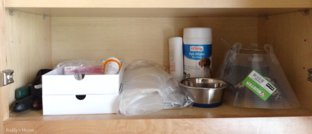 Dog supply organization - supplies in laundry room cabinet
