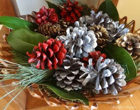 Our 2013 Christmas House - basket with pinecones greens and magnolia leaves