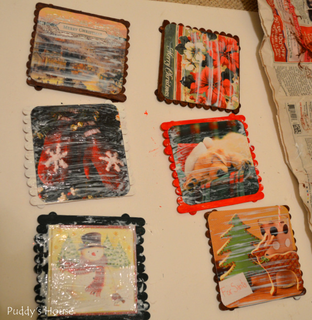 DIY mini pallet - christmas cards attached and coated with mod podge