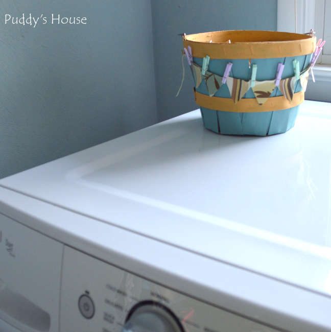 clothespin basket in laundry room